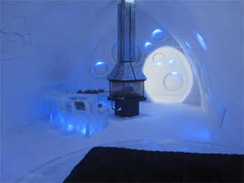 A premium deluxe suite with a woodstove at Quebec City's Ice Hotel. photos by Will McGough.