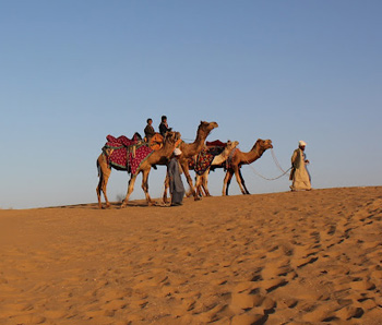 Camels and camel men at the Lakhmana Sand Dunes, Jaisalmer, Rajasthan