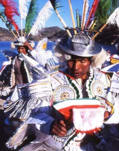 Morenada dancers, Island of the Sun, Lake Titicaca