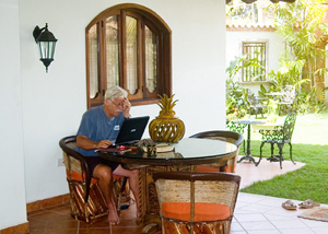 Barry working on a writing job on the porch of his house in Sayulita