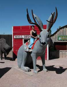 The author poses with a jackalope in Wall, South Dakota.