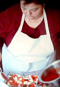Mamma Agata makes bruschetta.