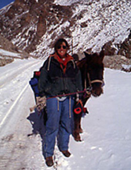 Wilson's wife Cheryl in the Himalayas with their faithful horse Sadhu.