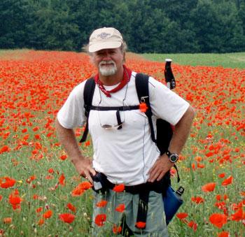 Brandon Wilson in a poppy field in Hungary