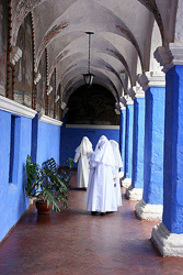 Sisters of Santa Catalina walk the halls.