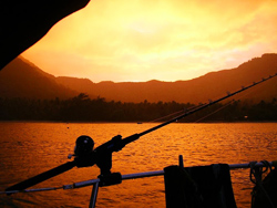 Fishing under a Nuku Hivan sunset.