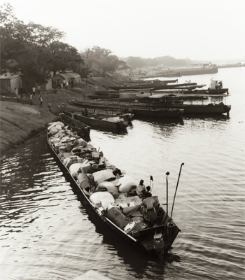 Long boats like this is how supplies are sent up river in a land where there are no roads to speak of.