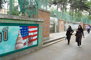 Thirty years later, the former American embassy is still lined with political posters struggling to provide Iranians with an enemy.
