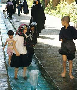 Children play at the water park in Tashan.
