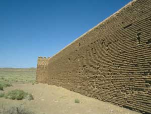 A restored caravanserai wall in the desert