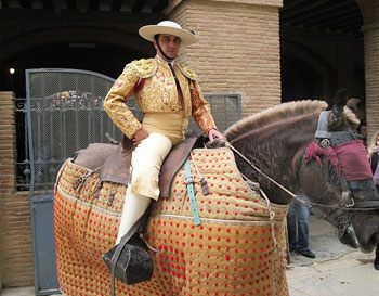 A picador on his blindfolded horse