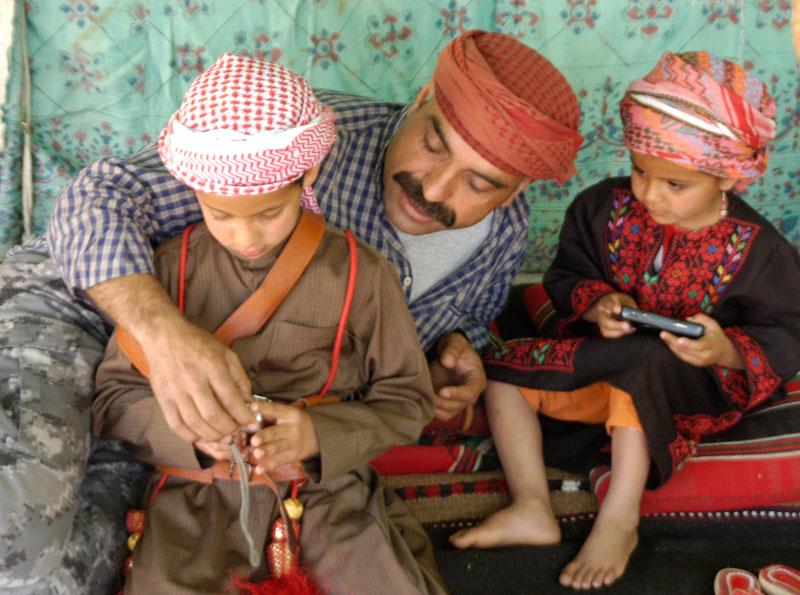 Kids with their dad in Jordan. Photo by Janis Turk.