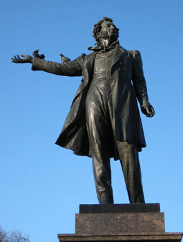 Alexander Pushkin greets you with an uplifted hand.