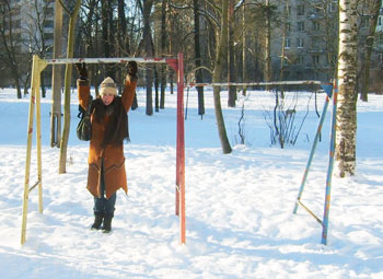 rusted swing set at Yuliya's childhood playground