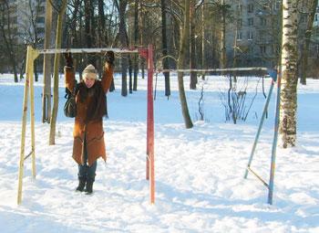 rusted swing set at Yuliya's childhood playground