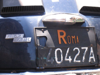 Classic license plate on a classic Italian car
