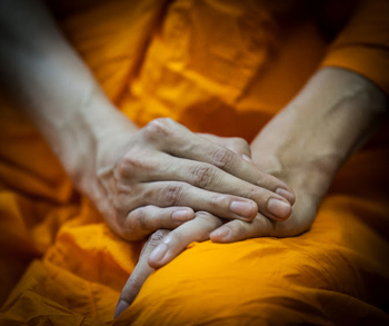 A monk's hands, Bangkok, Thailand. photos by Paul Shoul.