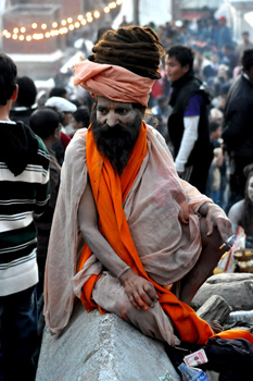 Sadhu dressed as Lord Shiva. His long hair is thought to be the home of the Ganges River.