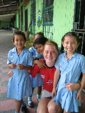 Schoolchildren in the Philippines with a Projects Abroad volunteer.