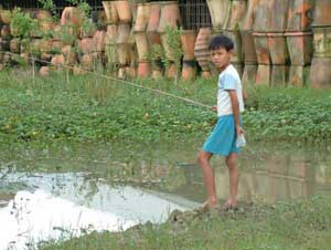 A Vietnamese boy fishing