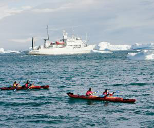 Voyagers on the Kapitan Khlebnikov take time out for kayaking in the Arctic Ocean. Photos courtesy of Adventure Life