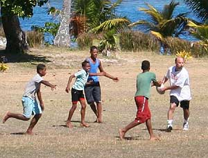 The author plays rugby with youngsters in Fiji.