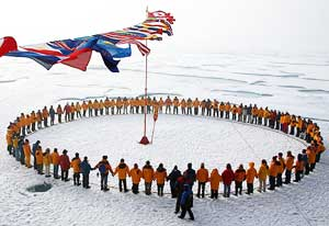 Members of an Adventure Life expedition form a circle at the North Pole.