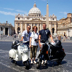 Vespa touring in Rome.