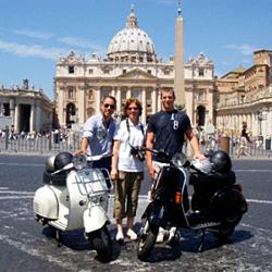 Vespa touring in Rome.