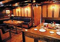 Inside the comfy saloon of the Soren Larsen.