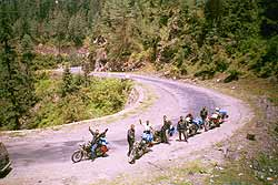 Bikers queue up to head up the mountainside.
