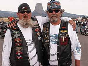 Harley enthusiasts pose in front of Devil's Tower, made famous in 'Close Encounters of the Third Kind.' Photo by David Rich