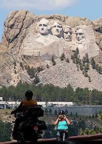 Bikers pose in front of Mt. Rushmore - photo by David Rich