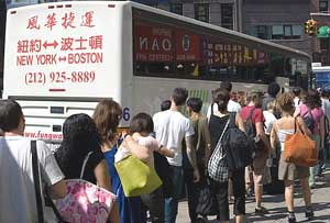 Riders wait in line to board a Fung Wah bus. Photos by Kevin McDermott