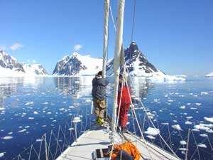 Passengers view Antarctic landscapes from the bow.