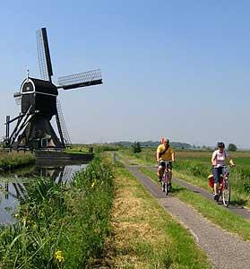 Biking by a windmill