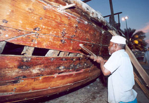 A craftsman repairs a dhow at the Dubai Heritage Village.