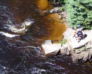 The rust colored water gives the Riviere Rouge its name in the Laurentian region of Quebec Province.