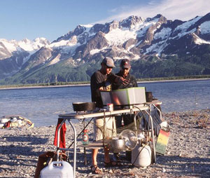 The famous Chilkat guides cooking with the Fairweather Range in the background
