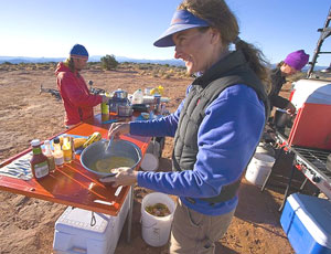 Maggie whips up our morning nosh at Airport Tower campground.