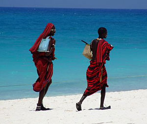 Massai warriors on the beach with sunglasses and cellphones