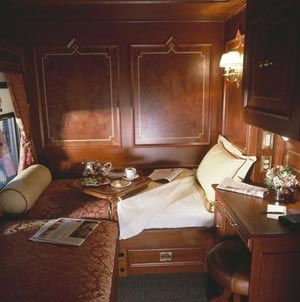 Can you believe this bedroom is on a train? Private railroad cars make U.S. luxury train travel a reality.