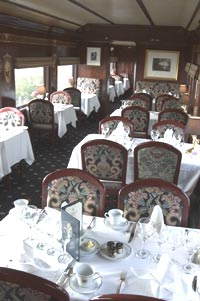 Dining in style on a private rail car from Trainshares, luxury train travel USA.