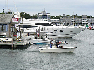 Big boats are docked in the Oak Bluffs Harbor, seen from the deck of the Fast Ferry from Rhode Island.