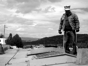 Railroad worker on roof of locomotive