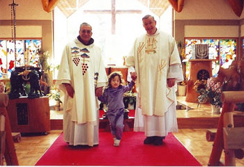 Padre Alba, little Miss Cash and visiting Monsignor Sanner after Mass