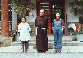 Father Gabriel Alba and Holy Family Mission staff