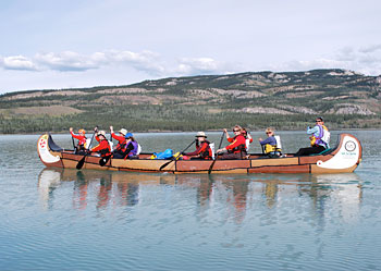 A voyager after ten hours of paddling on Lake Lebarge.