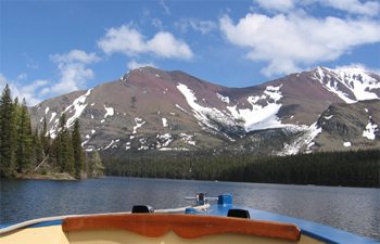 You can take a scenic tour in a boat of Two Medicine and other lakes in Glacier National Park.