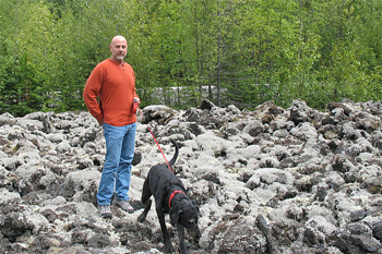 Jack the dog does not know what to make of the moss covered lava of the Nisga'a Memorial Lava Bed
